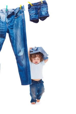 hang up: Toddler playing with denim clothes