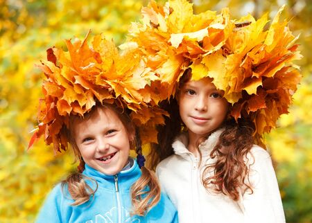 Two lovely little friends in autumnal headwreaths photo
