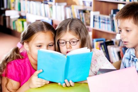 Intelligent kids reading a book