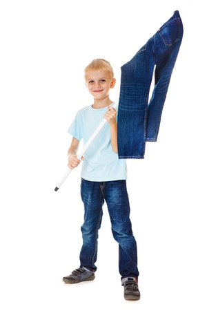 Smiling boy waving the flag made of denim wear Stock Photo - 15451184