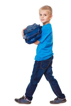 jeanswear: Boy holding jeanswear in hands