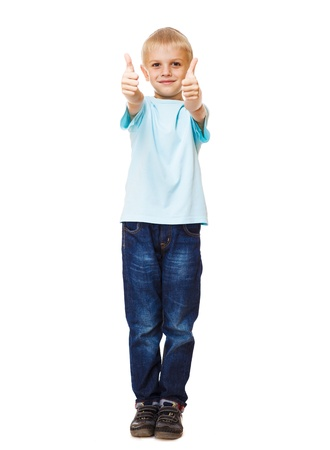 Cheerful boy in jeans showing thumb up Stock Photo - 15451183