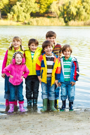 Cute kids group in rubber boots photo