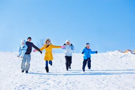 Emotional family in winter park Stock Photo
