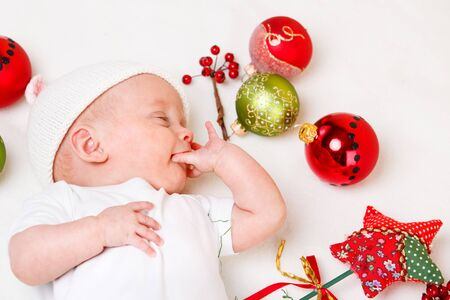 Cute infant and Christmas baubles photo