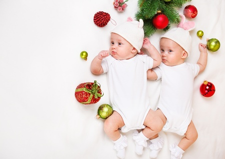 Christmas infant twins in funny hats