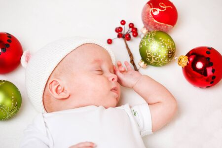 christmas baby: Sweet newborn Christmas baby sleeping Stock Photo