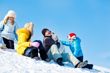 Joyful family enjoying winter leisure photo