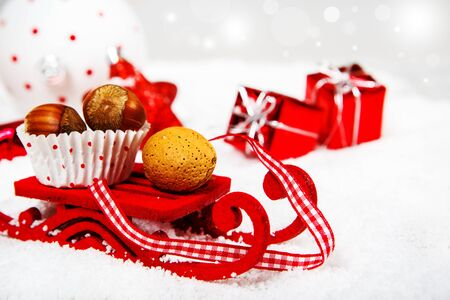 Christmas sleigh carrying hazelnuts and almonds Stock Photo - 16256401