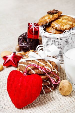 Red woolen heart, Christmas cookies and decoration, milk photo