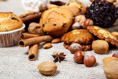 Nuts, species and cookies on burlap photo