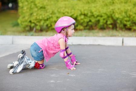 inline skater: Little beginner in roller skates