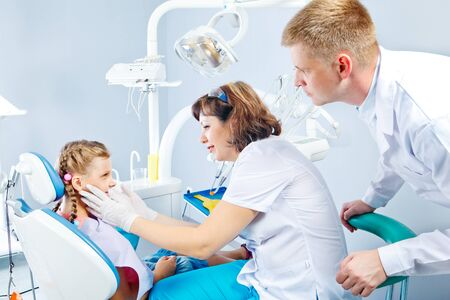 Dentist, medical assistant and a kid in dental office Stock Photo - 16568379