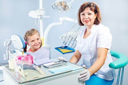 Dentist and a little patient photo