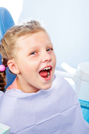 dental caries: Kid with dental caries opening mouth for oral exam Stock Photo