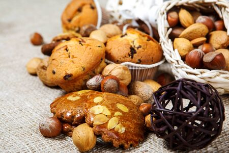 Fresh homemade pastry and nuts over coarse fabric photo