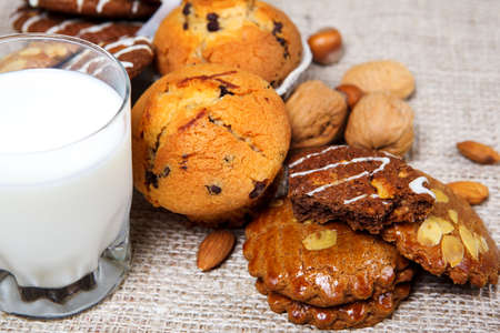 Tasty cookies with milk and nuts photo