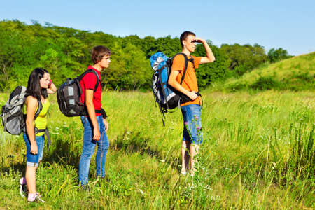Three teenage fellow backpackers hiking Stock Photo - 16609513