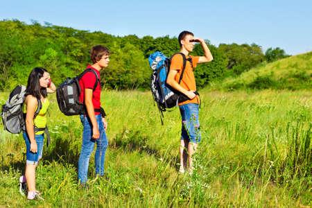 Three teenage fellow backpackers hiking Stock Photo - 16609513
