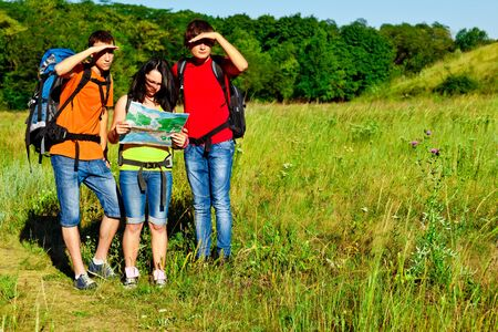 campus tour: Young backpackers looking for their way Stock Photo