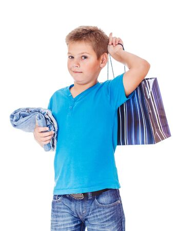 Boy in blue clothing holding shopping bag and new jeans Stock Photo - 16904779