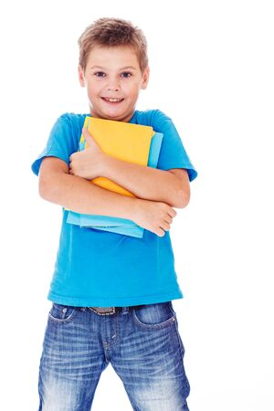 Smiling primary school student with books in hands Stock Photo - 16904784