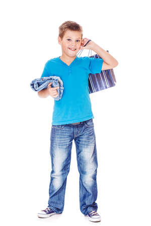 Cheerful boy holding jeans and shopping bag in hands Stock Photo - 16904781