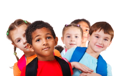Portrait of a school aged African American boy and his friends behind Stock Photo
