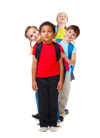 Kids group standing in a row Stock Photo