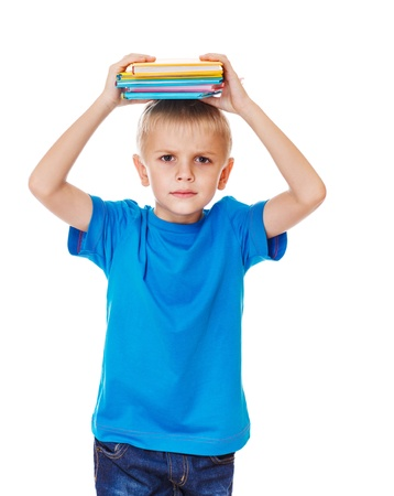 Angry primary school student with books over his head Stock Photo - 17798587