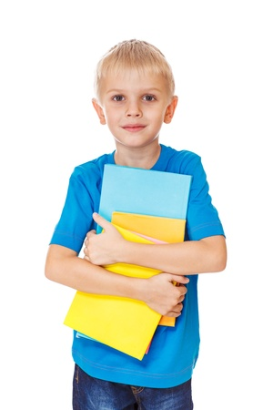 Boy holding books in colorful covers Stock Photo - 17798588