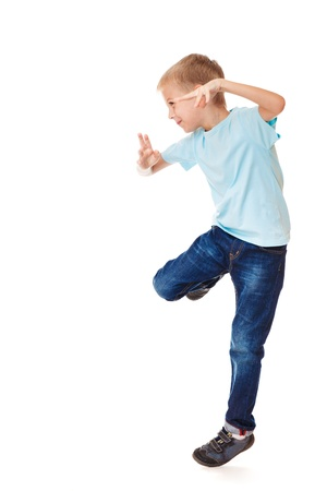 School aged boy in jeans, dancing