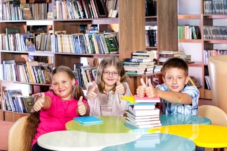 Emotional kids in a school library photo