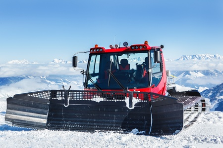 snowcat: Red snowcat high in mountains Stock Photo