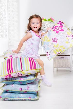 little princess: Little girl on the pillows