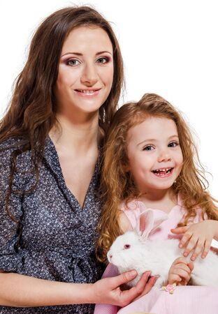 Mother and little girl with a white pet photo