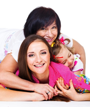 Happy young woman, her mother and daughter