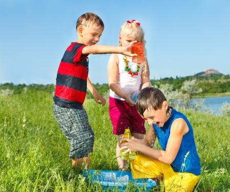 pumper: Kids splashing water in the meadow