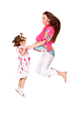 Cheerful jump of mother and daughter photo