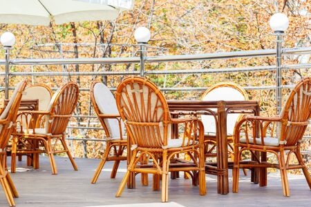 Stylish tables and chairs in an open air cafe terrace photo