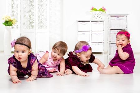 crawl: Beautiful baby girls group in festive dresses
