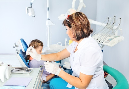 Child with a dentist Stock Photo - 18625702