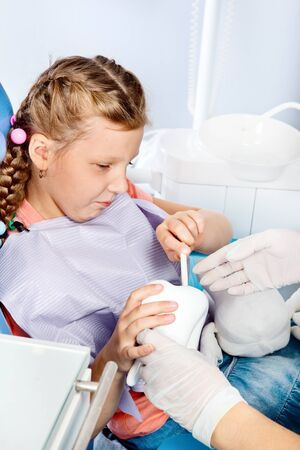 Little dentist patient playing with toy tooth Stock Photo - 18625693