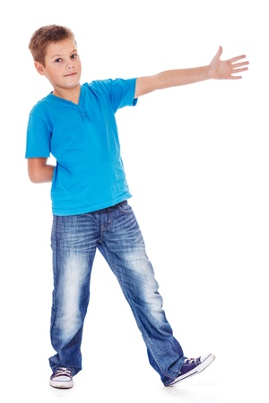primary school: School aged boy showing direction