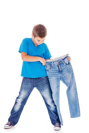 blue jeans kids: Boy trying on new jeans