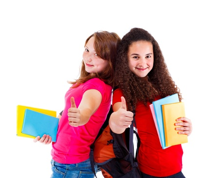 school aged: Lovely successful teens with books in hands, showing ok sign