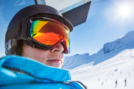 kitzsteinhorn: Portrait of a skier in protective helmet and goggles, riding a chairlift Stock Photo