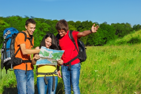 Young friendly tourists choosing their way photo