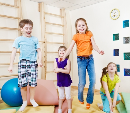 Excited jumping group of children photo