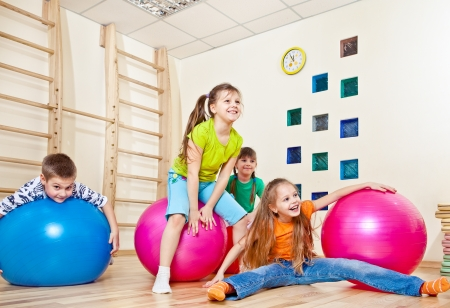Laughing kids in a gym photo